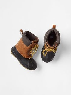 Duck boots for Birdie. She always wants to wear Eli's. Size 7/8.