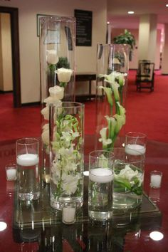 CALLA LILLIES AND CANDLES IN VASES