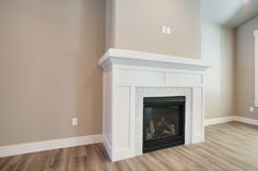 Custom Built mantle was made for this home! The Carrerra white backsplash ties…
