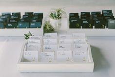 minimalistic escort cards - photo by Laura Goldenberger http://ruffledblog.com/palm-springs-wedding-for-a-creative-bride-and-groom