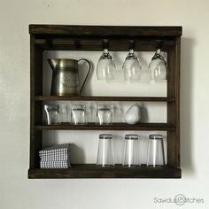 A great compromise of form and function.  This Pottery Barn inspired glass rack,  is part of a modular set that can be used in combination with other modular pieces (see image 2), or it can be used alone!