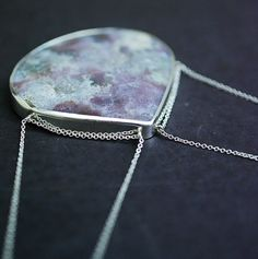 Don't know if it's day or night...moss agate in sterling silver necklace. via Etsy.