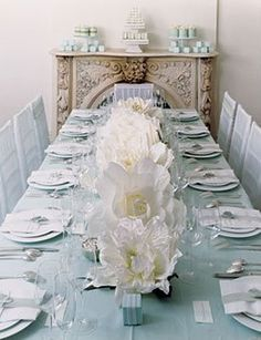 I think this is the most serene dinner table I have ever seen.  It just makes me want to have a glass of wine...white, of course, it goes with the decor.