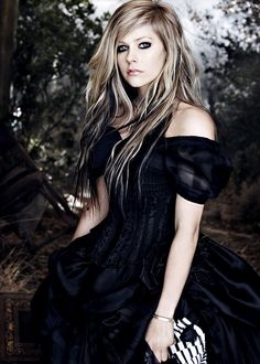 Avril Lavigne with the dress she wears in the music video of the song Alice. The song is written for the movie Alice in Wonderland.