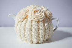 Knitted tea cosy with crocheted flowers | Etsy