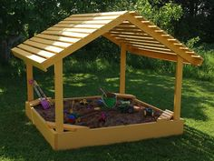 For the handy dad out there, this is a great weekend project. Assemble a nice, roomy sand box for the kids, complete with corner seats and a sun roof to protect them and keep the sand nice and dry.