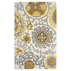 Bring bold style to your decor with this hand-loomed cotton rug, showcasing a striking suzani medallion motif.    Product: Rug