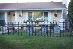 Create a graveyard fence for Halloween using PVC pipe and wood, making your house the spookiest on the block!