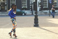 Bella Adeleke of Prettygarbe.com in an Orange Culture print pant