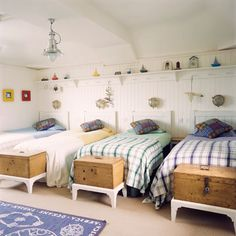 This beachy bedroom has everything a sailor would need, from an ocean blue navigation rug to trunks and lights at each bed. (Krystin H. pinned this idea from redonline.co.uk.)  Photo Source: redonline.co.uk