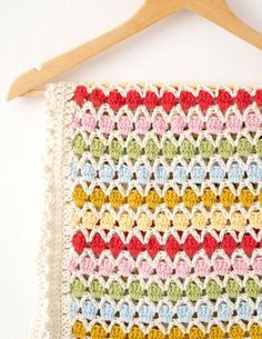 Crochet your own Baby Blanket! Easy to make with full instructions. Includes lots of photos to guide you through making this lovely bright blanket for your baby or as a wonderful, colorful gift. Find the pattern on the LoveCrochet website. Crochet Afghans, Crochet Motifs, Crochet Blanket Patterns, Baby Blanket Crochet, Baby Patterns, Crochet Stitches, Crochet Baby, Knit Crochet, Knitting Patterns