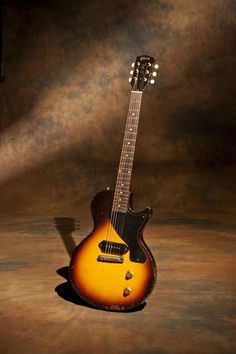 1956 Gibson Les Paul Junior in a sunburst finish… Gibson offered these guitars from 1954 thru early 1959 in two colors, sunburst and TV yellow. The TV yellow being the most desirable and designed to show up on a standard black and white television of the era. Bare bones and simple the P-90 pickup was a killer combination of brightness but enough power to achieve overdrive from the amps of the day.