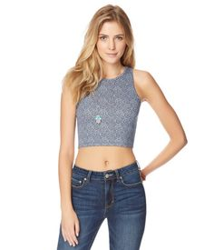 """Get in touch with your artsy side and tug on our Geo Crop Tank before hitting the Picasso exhibit! It's decorated with a totally unique pattern to catch any passerby's eye, and the soft material promises a comfy feel while you attempt your own masterpiece.<br><br>Slim fit. Approx. length: 16""""<br>Style: 1294. Imported.<br><br>62% polyester, 34% rayon, 4% spandex.<br>Machine wash/dry.<br><br>Model height: 5'9.5""""; Size: Small."""