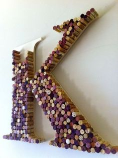Giant Letter made with corks_ I SO want to do this in our new home, sadly I have the corks all ready :) M