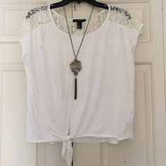 "Tie lace crop top White tie front top with lace sleeve and back detail. No damage barely worn. Measures 20"" from shoulder to hem Forever 21 Tops"