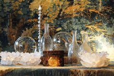 Glass display with tapestry ~ Source: Bie Baert Antiques & Decorations,  Antwerp, Belgium.
