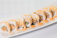 Hamachi Lover($11.95) - Spicy yellow tail, cucumber topped w/yellow tail, spicy mayo sauce.