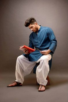 Complete Your Traditional Look With The Best Ethnic Footwear is part of Islamic fashion men - Traditional outfits ask for the apt footwear As it increases the elegance of the outfit and takes the look to a whole 'nother level Wedding Kurta For Men, Wedding Dresses Men Indian, Wedding Dress Men, Kurta Pajama Men, Kurta Men, Boys Kurta, Indian Men Fashion, Mens Fashion, Fall Fashion
