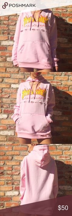 Pink V-neck distressed long THRASHER hoodie Distressed V-neck light pink THRASHER hoodie! A little rough around the edges but cute a must for any closet! Thrasher Sweaters