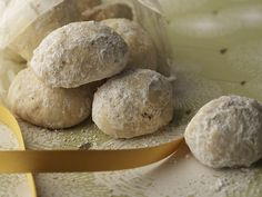 Kourabiedes (Greece): Walnut Sugar Cookies    Kourabiedes are Greek celebration cookies. At Christmas, it's traditional to stick a whole clove on top of the walnut sugar cookies to represent the gift of spices that the Three Wise Men brought Mary.
