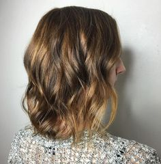 Medium Brown Hairstyle With Subtle Highlights