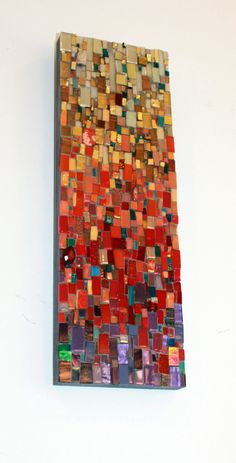 Progression in Warms  Color study:  a variety of hand cut glass, found objects, recycled glass, tumbled stones, semi-precious stones, beads.  All glass was hand cut by the artist, Ariel Finelt Shoemaker. Inquiries welcome: http://www.mosaicsbyariel.com #mosaics