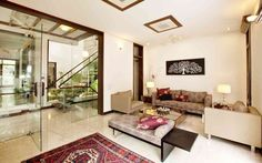 Find home projects from professionals for ideas & inspiration. K Residence Gurgaon by Kumar Moorthy & Associates Bungalow Living Rooms, Bungalow House Design, Living Room Remodel, Indian Living Rooms, Boho Living Room, Luxury Homes Exterior, Interior Design Photos, Living Room Flooring, Home Remodeling