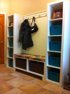 Photo 1: I put all my pins together and created this mudroom: 2 Ikea Expedit Shelves and 1 Besta shelf unit with legs ($192), Target Bins, Home Depot double hooks, a sheet of bead board and decorative molding. Works great for a family of 5. The trick is the wall of hooks on the other side!