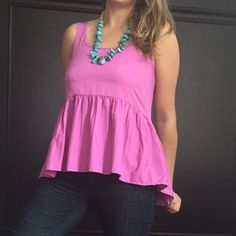 American Eagle Outfitters ruffle hi-lo peplum tank This is darling for under a cozy sweater for fall! Ruffles on the bottom and a high-low hem on the bottom. 100% polyester. Bit too tight in the bust for me so it has to find a new home. American Eagle Outfitters Tops Tank Tops