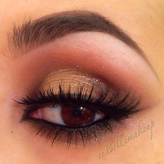 Gold eyeshadow closeup makeup lashes