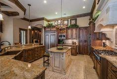 Mediterranean Kitchen with High ceiling, Pendant light, Crown molding, Limestone Tile, Farmhouse sink, U-shaped, Raised panel