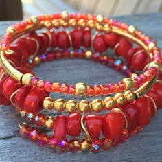 Elegant! Natural fiery red coral, fire polished Czech glass in red and fuchsia and 14k gold fill. Beaded bracelet on memory wire. Available at www.etsy.com/shop/yellowmangobracelets