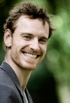 Michael Fassbender. He usually looks all broody in photographs, but this is a nice change. Cute!
