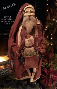 Arnett's Primitive Santa Holding Jack In The Box