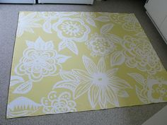 I saw some beautiful painted floor cloths at a Craft Show that I attended this past winter. Since then, I have been inspired to make one for my laundry room. I checked out some instructions on t...