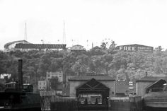 Edgewater ferry terminal below the cliffs. Palisades Amusement Park above. Palisades Amusement Park, Palisades Park, Cliffside Park, Washington Heights, Auld Lang Syne, Bergen County, New Jersey, All Over The World, Paris Skyline