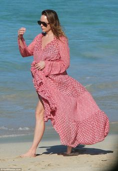 Sun and sand! Allowing a glimpse of sun to tan her legs, Stella gathered the billowing piece by her waist as she walked bare-foot along the warm sands