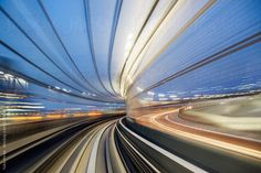 Speed and motion from fast train in tunnel by yukohirao   Stocksy United