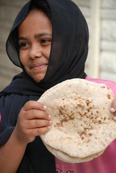young girl with bread