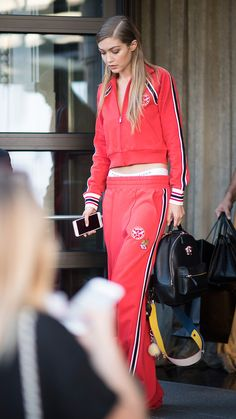 Gigi Hadid in a red tracksuit | Best Street Style Outfits from Milan Fashion Week Spring 2017