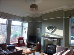 An Edwardian sitting room with Pigeon on the main body of the walls and Blue Gray above the picture rail. Off White is used on the ceiling and woodwork and the cornice and the ceiling rose is in Pointing. From via the Farrow & Ball inspiration site Yellow Walls Living Room, Farrow And Ball Living Room, Living Room Grey, Home And Living, Living Room Decor, Living Rooms, Living Spaces, Living Room Inspiration, Home Decor Inspiration