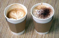Simple takeaway coffee cups with cardboard sleeves.