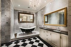 Sparkling chandelier for the black and white bathroom [Design: Oswald Homes]