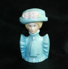 Avon thimble.  I have 4 of the lady Avon Thimbles, and would be willing to sell them. Send me a comment if interested.