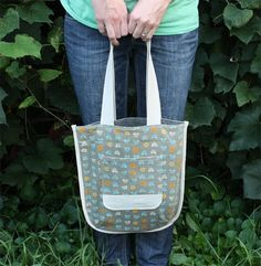 Noodlehead: the library tote tutorial. Might try this bag idea with French seams instead of bias tape.