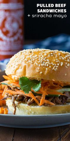 Banh Mi inspired pulled beef sandwiches.  Honey Garlic Beef is topped with fresh carrots and cucumber and a spicy sriracha mayo!