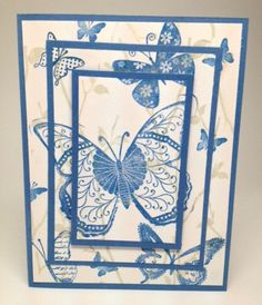 Triple stamped butterflies on vanilla and blue paper