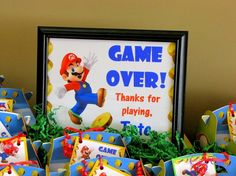 One stop shop for all Mario party ideas. I love this for the party favor table.