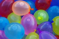 """Baby Shower game. Break the water. Pin up any number of balloons, number them, then give each guest one dart. The one to pop and """"break the water"""" gets a prize associated with that number on the balloon."""
