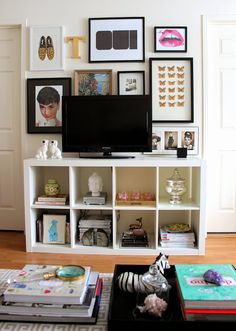 very similar to my TV wall. i like that all the wires are concealed and the pictures behind the TV